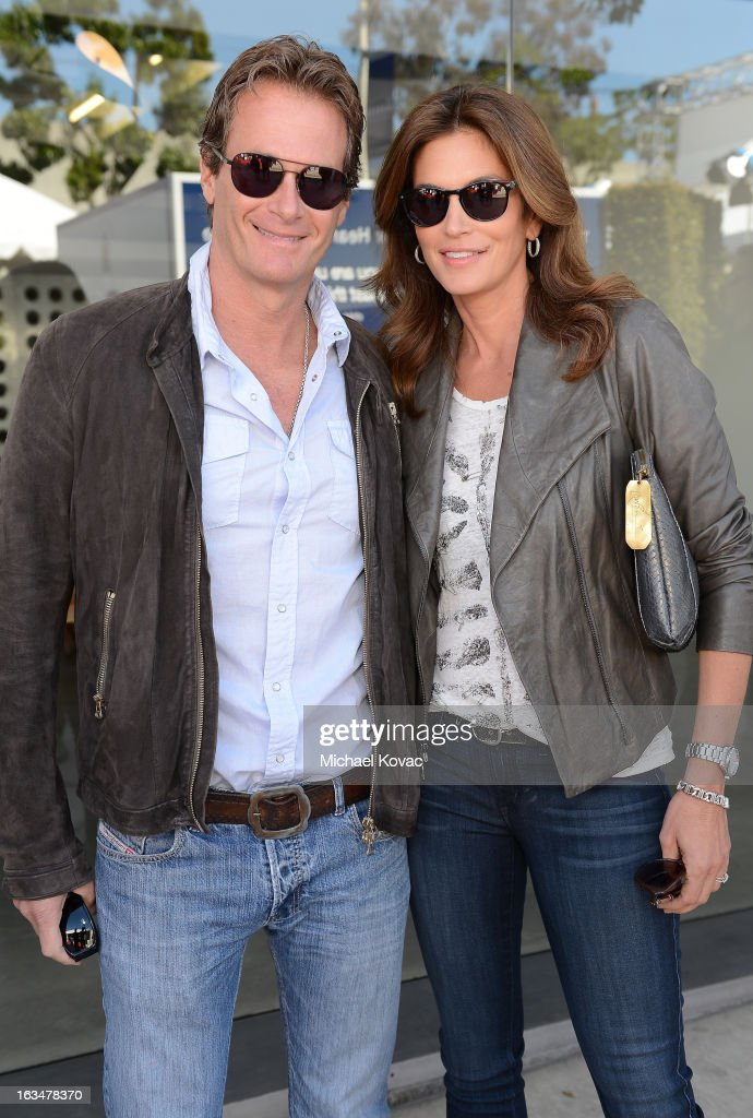 <a gi-track='captionPersonalityLinkClicked' href=/galleries/search?phrase=Rande+Gerber&family=editorial&specificpeople=549565 ng-click='$event.stopPropagation()'>Rande Gerber</a> (L) and <a gi-track='captionPersonalityLinkClicked' href=/galleries/search?phrase=Cindy+Crawford&family=editorial&specificpeople=202842 ng-click='$event.stopPropagation()'>Cindy Crawford</a> wearing John Varvatos Eyewear at the 10th Annual Stuart House Benefit presented by Chrysler at John Varvatos Los Angeles on March 10, 2013 in Los Angeles, California.