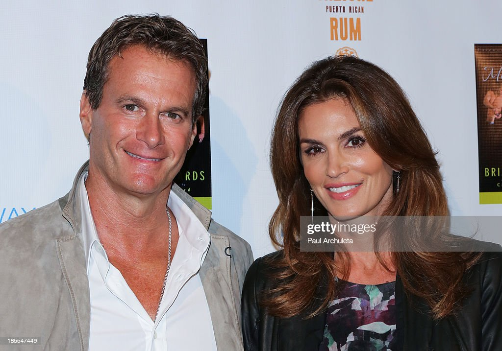 <a gi-track='captionPersonalityLinkClicked' href=/galleries/search?phrase=Rande+Gerber&family=editorial&specificpeople=549565 ng-click='$event.stopPropagation()'>Rande Gerber</a> (R) and Model / TV Personality <a gi-track='captionPersonalityLinkClicked' href=/galleries/search?phrase=Cindy+Crawford&family=editorial&specificpeople=202842 ng-click='$event.stopPropagation()'>Cindy Crawford</a> (L) attend the launch party for Brian Edwards' new book 'Enter Miss Thang' at Cafe Habana on October 21, 2013 in Malibu, California.