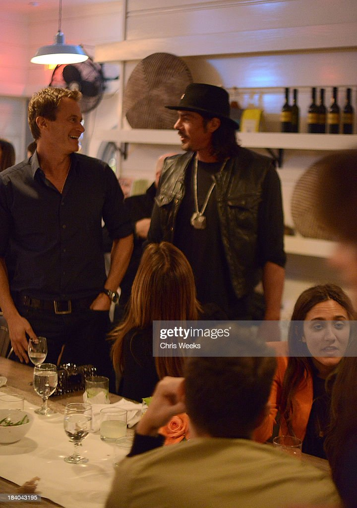 Rande Gerber and Tim Medvetz attend a dinner for Gareth Pugh hosted by Chrome Hearts at Malibu Farm on October 10, 2013 in Malibu, California.