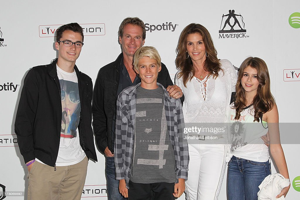 <a gi-track='captionPersonalityLinkClicked' href=/galleries/search?phrase=Rande+Gerber&family=editorial&specificpeople=549565 ng-click='$event.stopPropagation()'>Rande Gerber</a>, <a gi-track='captionPersonalityLinkClicked' href=/galleries/search?phrase=Cindy+Crawford&family=editorial&specificpeople=202842 ng-click='$event.stopPropagation()'>Cindy Crawford</a> and family attend the Guy Oseary's July 4th event in Malibu presented by Spotify and Live Nation with DeLeon and VitaCoco at Nobu Malibu on July 4, 2013 in Malibu, California.