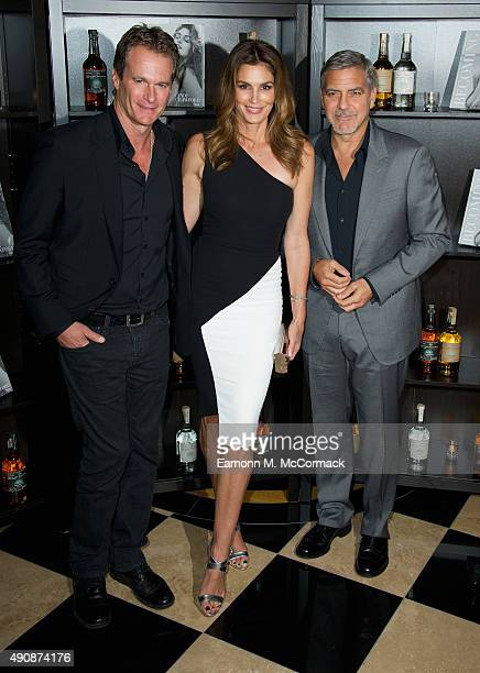 Rande Gerber Cindy Crawford and George Clooney attend the Casamingos Tequila Cindy Crawford book launch party at The Beaumont Hotel on October 1 2015...