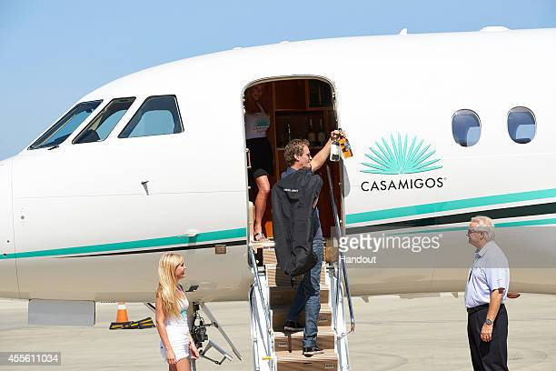 Rande Gerber is seen loading 100 cases of Blanco Reposado and the newly launched Anejo Casamigos Tequila September 17 2014 at the Van Nuys Airport in...