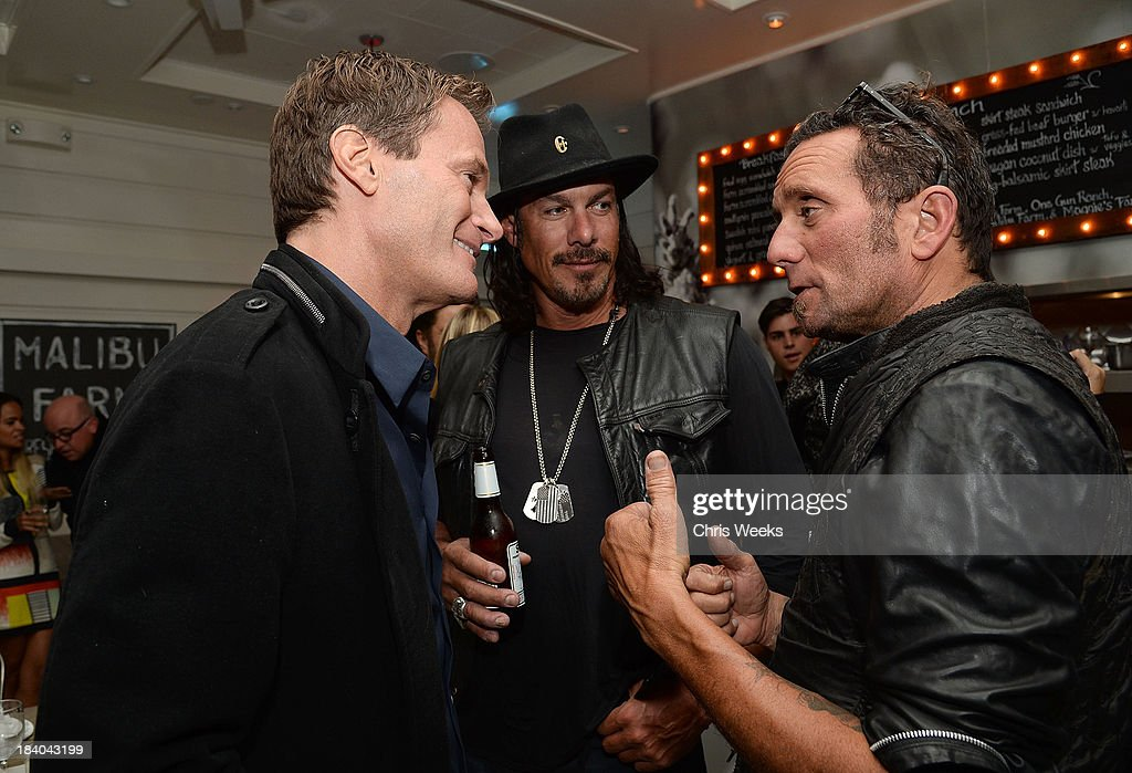 <a gi-track='captionPersonalityLinkClicked' href=/galleries/search?phrase=Rande+Gerber&family=editorial&specificpeople=549565 ng-click='$event.stopPropagation()'>Rande Gerber</a>, Tim Medvetz and Richard Stark attend a dinner for Gareth Pugh hosted by Chrome Hearts at Malibu Farm on October 10, 2013 in Malibu, California.