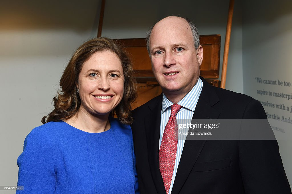 Randolph Churchill (R) and his wife Catherine Churchill open an exhibition of Winston Churchill's paintings to coincide with the 80th anniversary celebration of the Queen Mary's maiden voyage at The Queen Mary on May 27, 2016 in Long Beach, California.