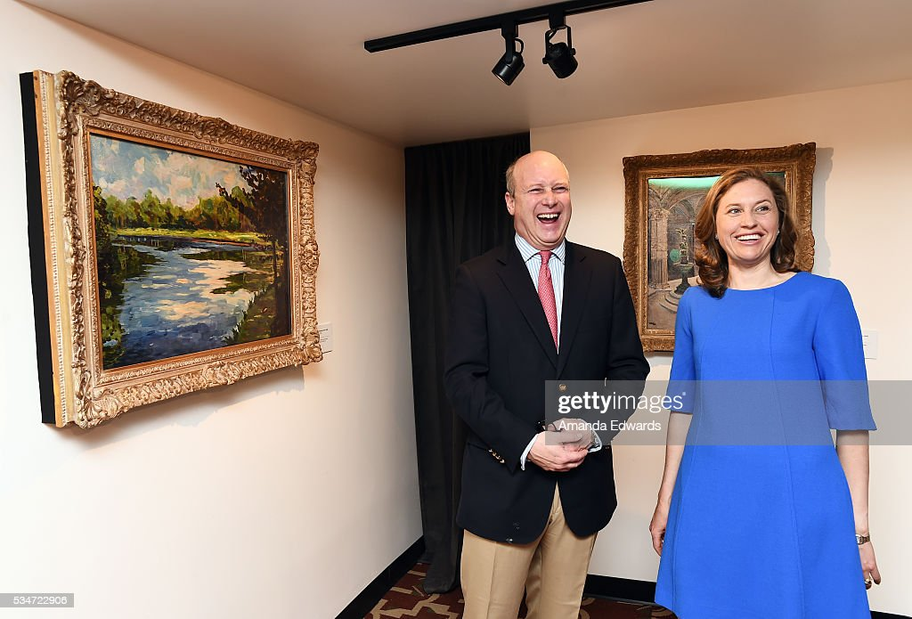 Randolph Churchill (L) and his wife Catherine Churchill open an exhibition of Winston Churchill's paintings to coincide with the 80th anniversary celebration of the Queen Mary's maiden voyage at The Queen Mary on May 27, 2016 in Long Beach, California. All paintings are copyright of the Churchill Heritage Limited.