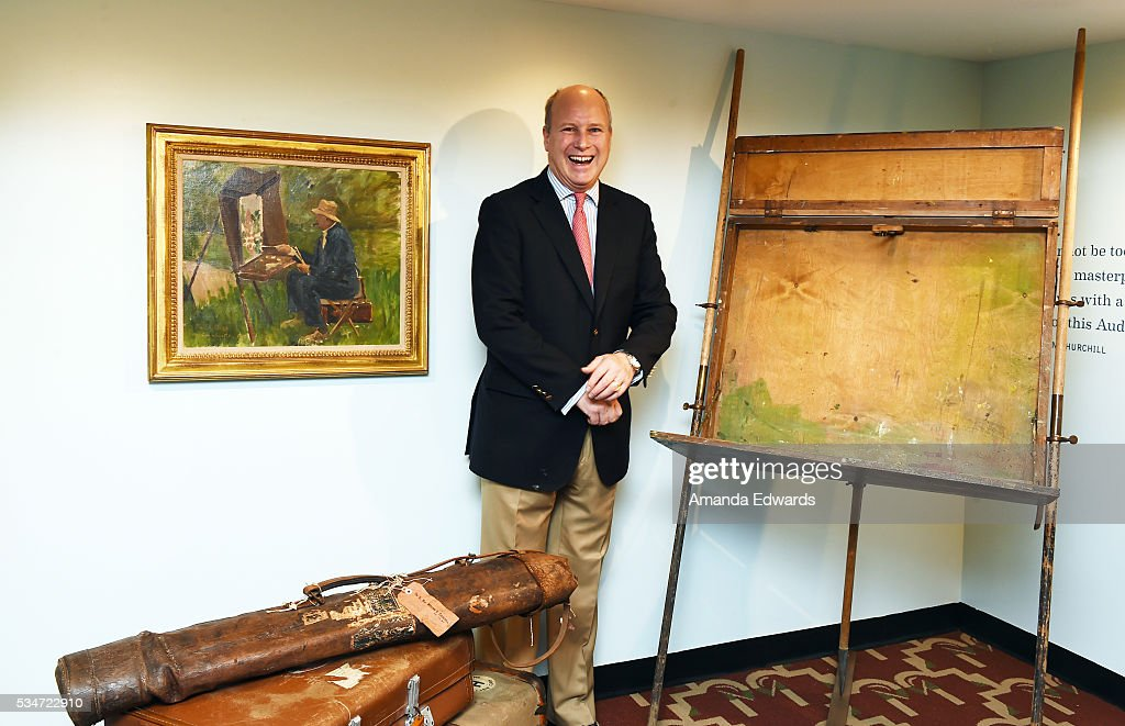 Randolph Churchill stands next to his great grandfather Winston Churchill's travel easel and bag at the opening of an exhibition of Winston Churchill's paintings to coincide with the 80th anniversary celebration of the Queen Mary's maiden voyage at The Queen Mary on May 27, 2016 in Long Beach, California. All paintings are copyright of the Churchill Heritage Limited.