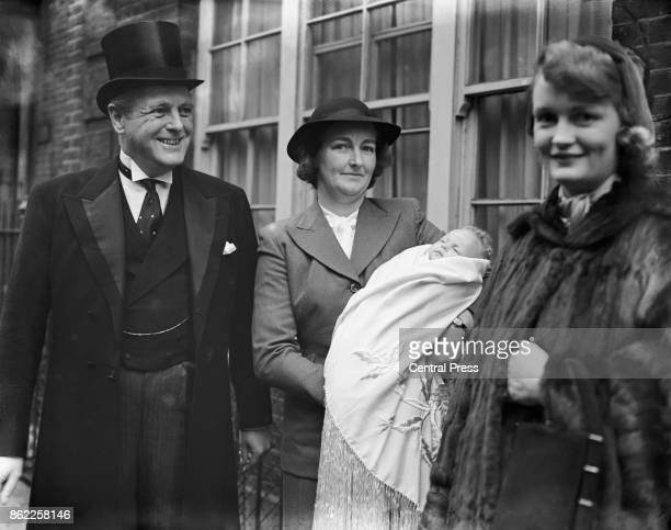Randolph Churchill the son of Winston Churchill leaves home with his wife June and their baby daughter Arabella for Arabella's christening 8th...