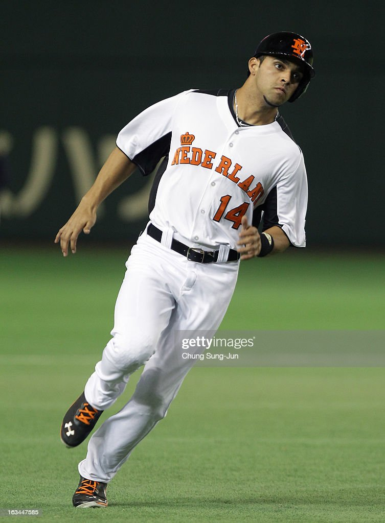 Randolph Oduber # 14 of Netherlands runs into third base in the sixth inning during the World Baseball Classic Second Round Pool 1 game between Japan and the Netherlands at Tokyo Dome on March 10, 2013 in Tokyo, Japan.