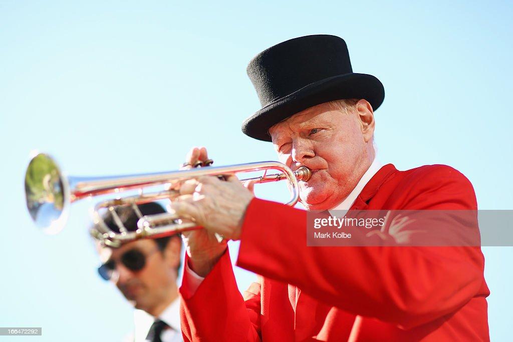 Randwick's resident bugler, Bob Bouffler plays on Australian Derby Day at Royal Randwick Racecourse on April 13, 2013 in Sydney, Australia.