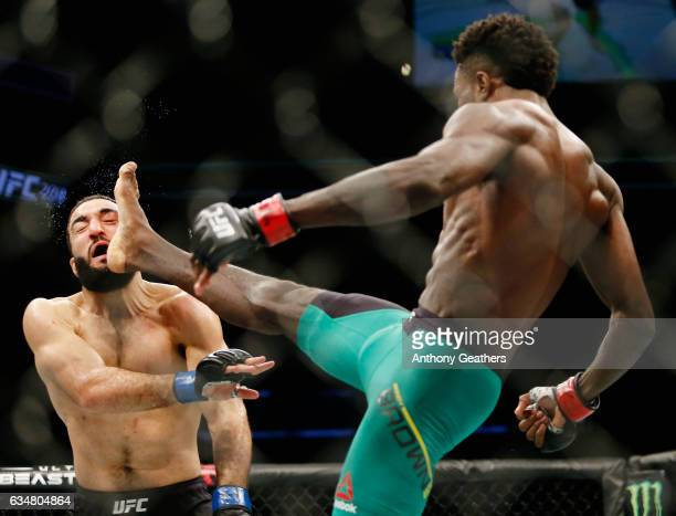 Randy Brown of Jamaica lands a kick against Belal Muhammad of United States in their welterweight bout during UFC 208 at the Barclays Center on...