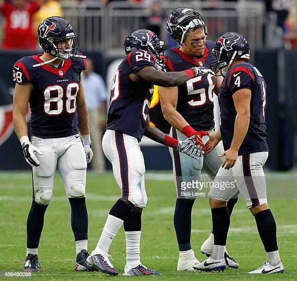 Randy Bullock of the Houston Texans is congratulated by Brian Cushing Andre Hal and Garrett Graham after scoring a 55 yard field goal at NRG Stadium...
