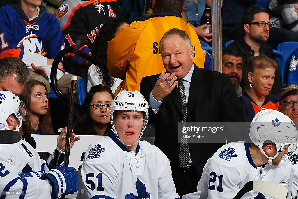Randy Carlyle of the Toronto Maple Leafs looks on from the bench against the New York Islanders at Nassau Veterans Memorial Coliseum on October 21...