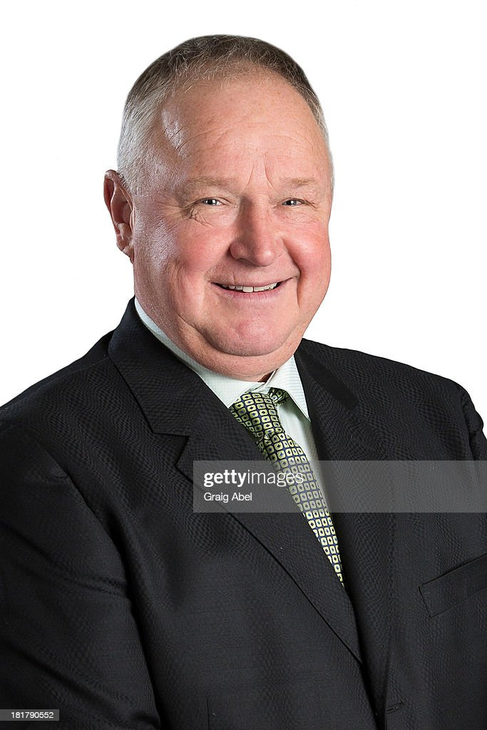 Randy Carlyle of the Toronto Maple Leafs poses for his official headshot for the 2013-2014 season on September 11, 2013 at the Mastercard Centre in Toronto, Ontario, Canada.