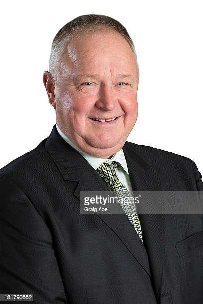 Randy Carlyle of the Toronto Maple Leafs poses for his official headshot for the 20132014 season on September 11 2013 at the Mastercard Centre in...