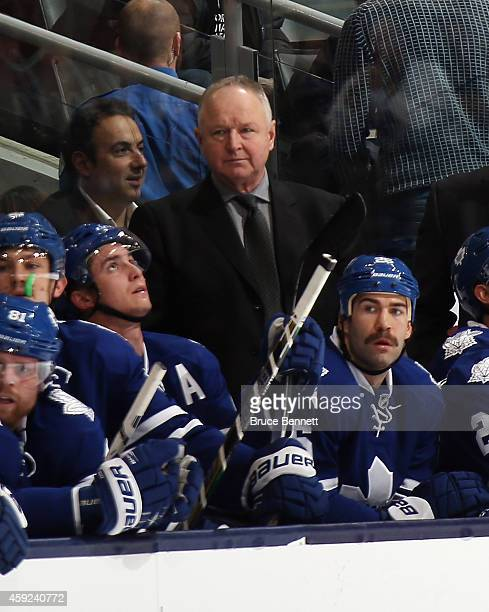Randy Carlyle of the Toronto Maple Leafs works the game against the Nashville Predators at the Air Canada Centre on November 18 2014 in Toronto...