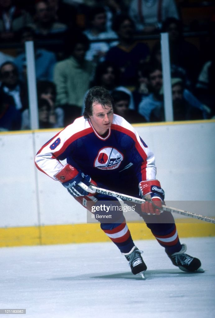 Randy Carlyle of the Winnipeg Jets skates on the ice during an NHL game in March 1985
