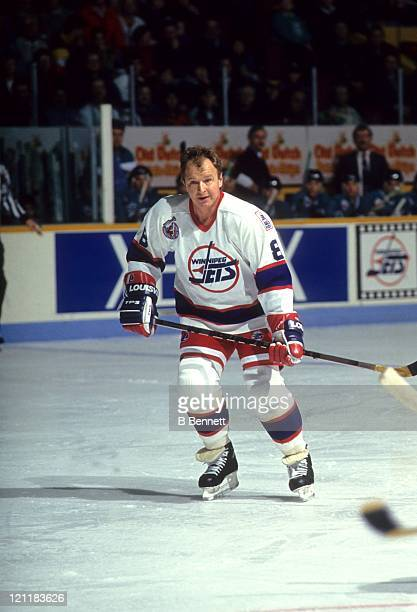 Randy Carlyle of the Winnipeg Jets skates on the ice during an NHL game against the San Jose Sharks on December 21 1992 at the Winnipeg Arena in...