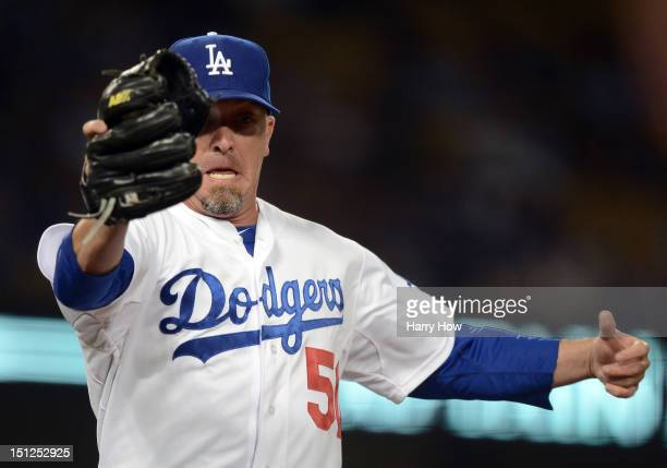 Randy Choate of the Los Angeles Dodgers reacts as he makes a catch at first base for an out of Mark Kotsay of the San Diego Padres to end the eighth...