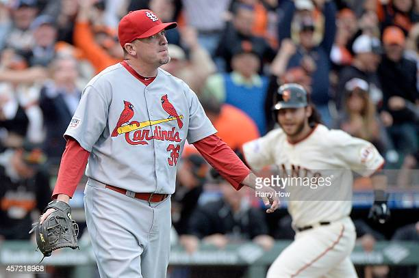 Randy Choate of the St Louis Cardinals reacts after an error leads to the winning run as Brandon Crawford of the San Francisco Giants scores as the...