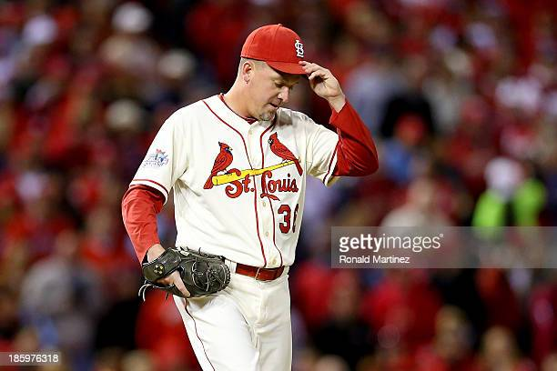 Randy Choate of the St Louis Cardinals walks back to the dugout after being pulled from the game in the sixth inning against the Boston Red Sox...