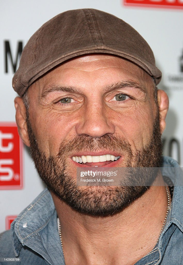 <a gi-track='captionPersonalityLinkClicked' href=/galleries/search?phrase=Randy+Couture&family=editorial&specificpeople=881313 ng-click='$event.stopPropagation()'>Randy Couture</a> attends the Grand Opening of Robert Earl's Planet Dailies & Mixology 101 at The Farmer's Market on April 5, 2012 in Los Angeles, California