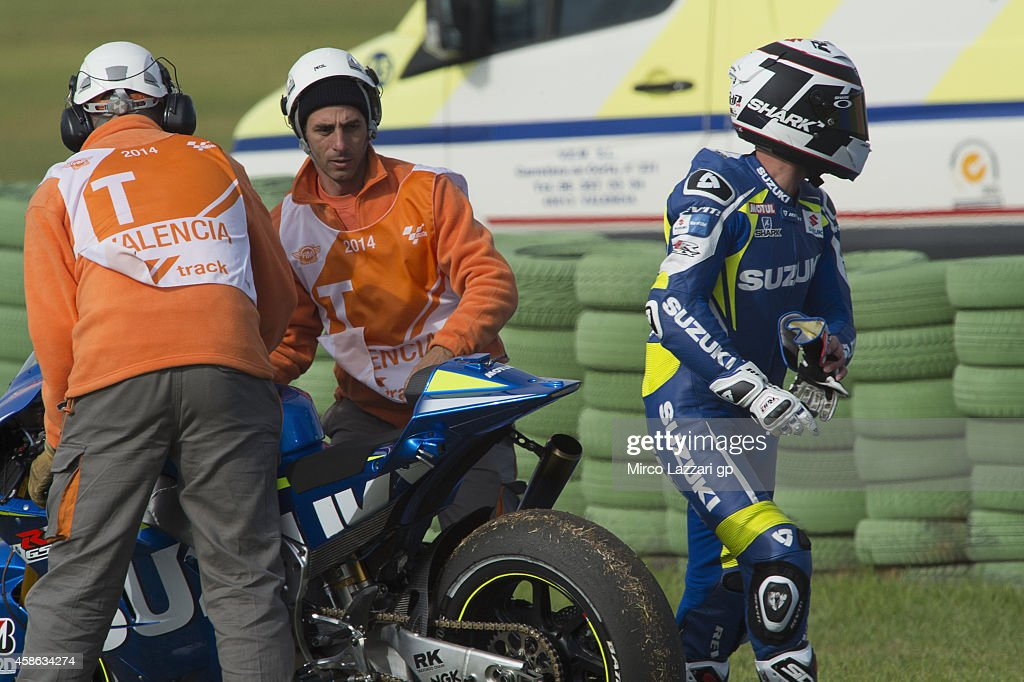 Randy De Puniet of France and Suzuki Test Team crashed out during the MotoGP of Valencia Qualifying at Ricardo Tormo Circuit on November 8 2014 in...