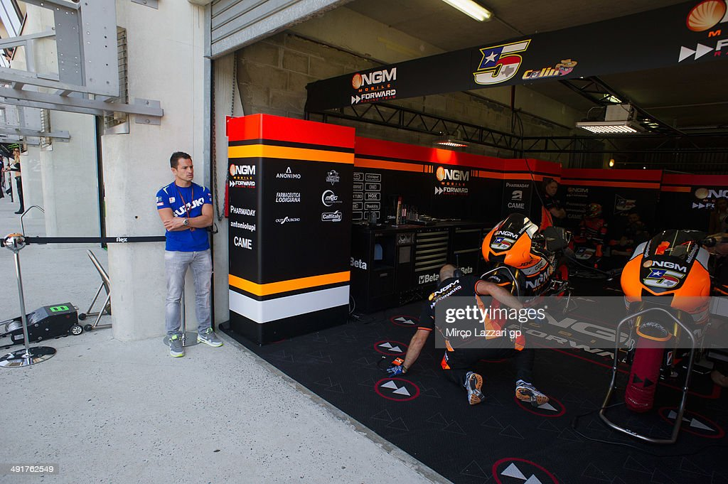 Randy De Puniet of France and Suzuki Test Team looks on in fornt of box during the MotoGp of France Qualifying at on May 17 2014 in Le Mans France