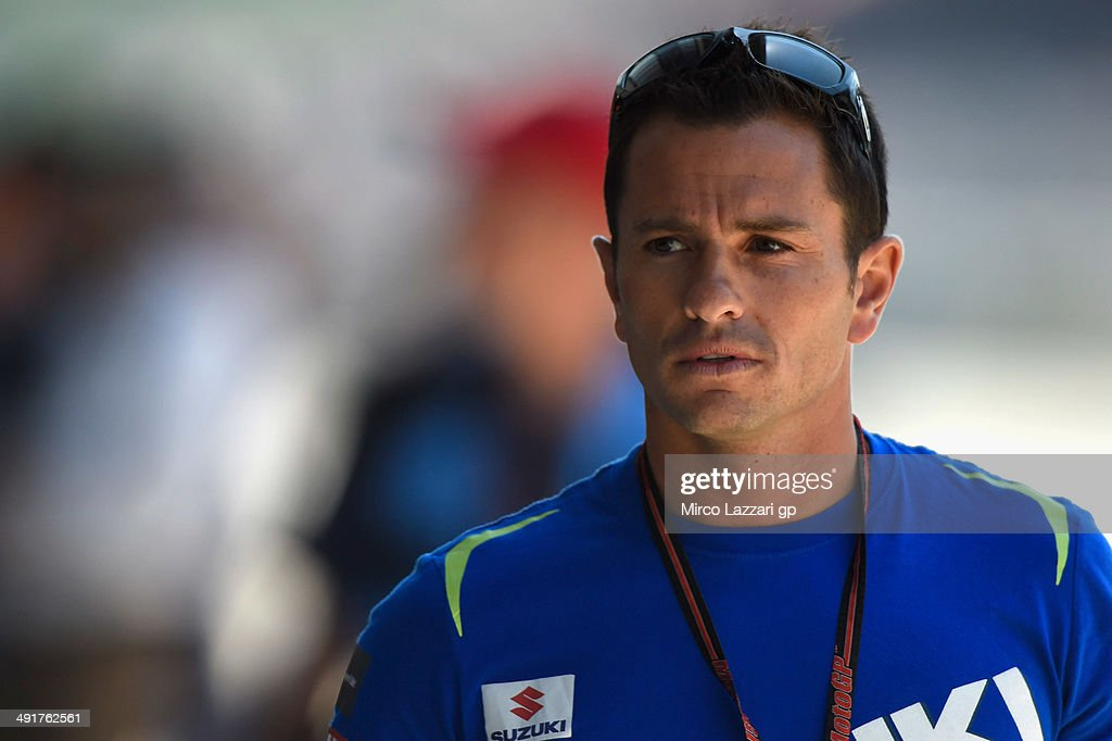 Randy De Puniet of France and Suzuki Test Team looks on in pit during the MotoGp of France - Qualifying at on May 17, 2014 in Le Mans, France.