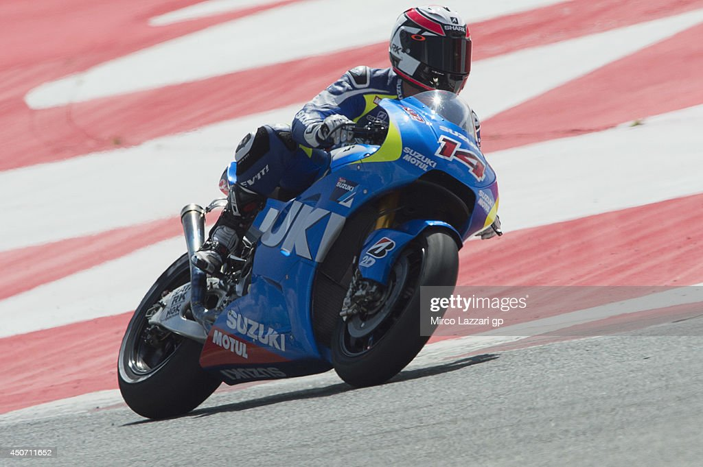 Randy De Puniet of France and Suzuki Test Team rounds the bend during the MotoGp Tests In Montmelo at Circuit de Catalunya on June 16 2014 in...