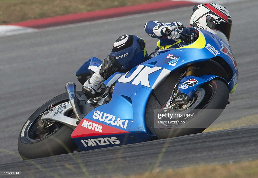 Randy De Puniet of France and Suzuki Test Team rounds the bend during the MotoGP Tests in Sepang Day One at Sepang Circuit on February 26 2014 in...
