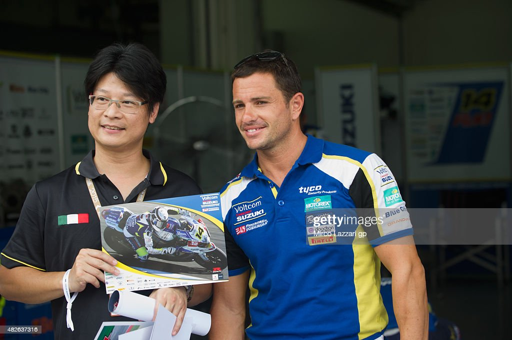 Randy De Puniet of France and Voltcom Crescent Suzuki poses with fan in box during the FIM Superbike World Championship Qualifying at Sepang Circuit...