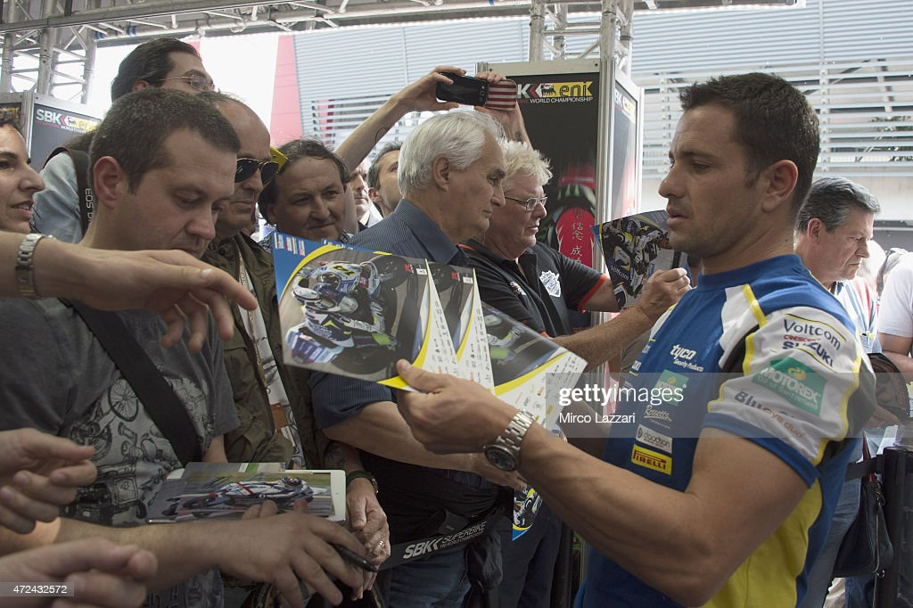 Randy De Puniet of France and Voltcom Crescent Suzuki signs autographs for fans at the paddock show during the World Superbikes Preview at Enzo Dino...