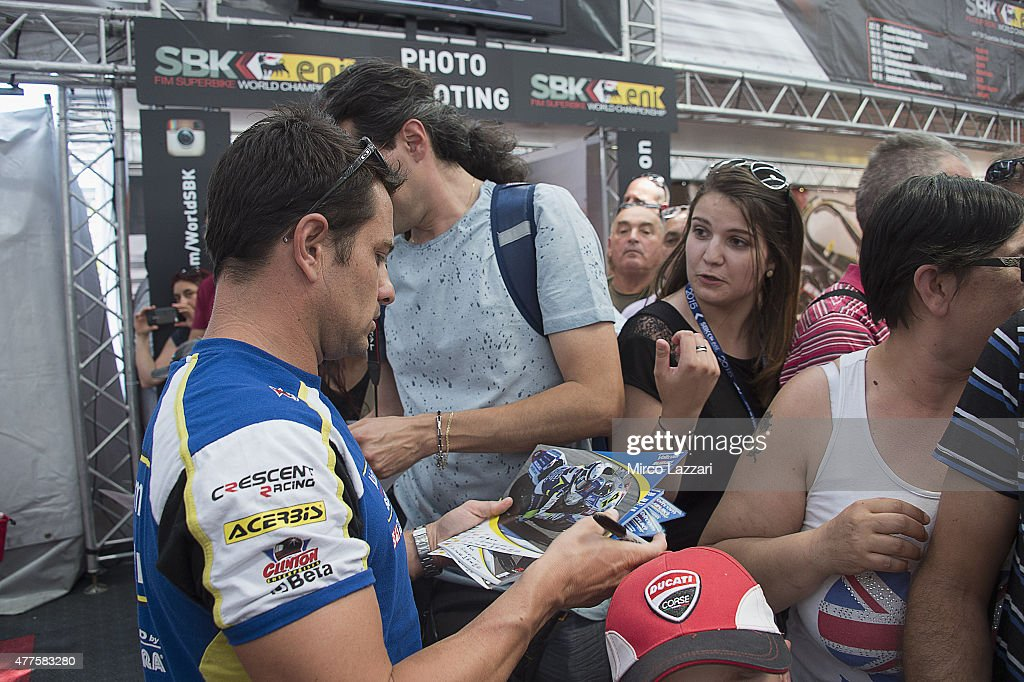 Randy De Puniet of France and Voltcom Crescent Suzuki signs autographs for fans during the paddock show during the FIM Superbike World Championship...