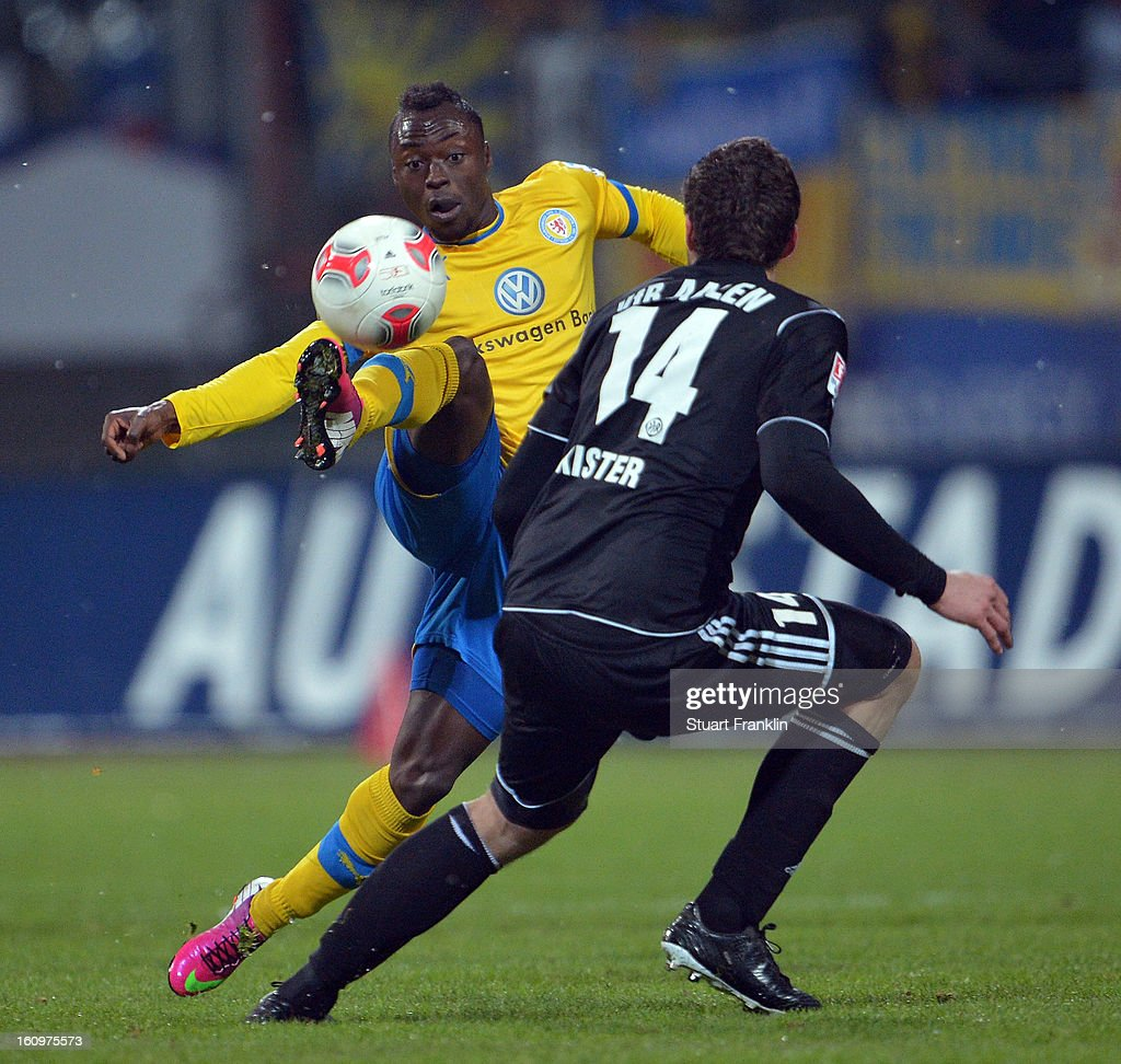 Randy Edwini Bonsu of Braunschweig is challenged by Tim Kister of Aalen during the second Bundesliga match between Eintracht Braunschweig and VfR Aalen at Eintracht Stadion on February 8, 2013 in Braunschweig, Germany.