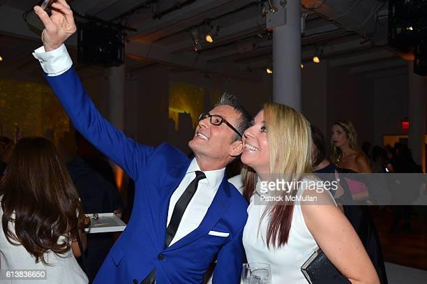 Randy Fenoli and Stephanie Prenatt pose for a selfie at Martha Stewart Weddings Bridal Fashion Week Party at Hudson Mercantile on October 10 2016 in...