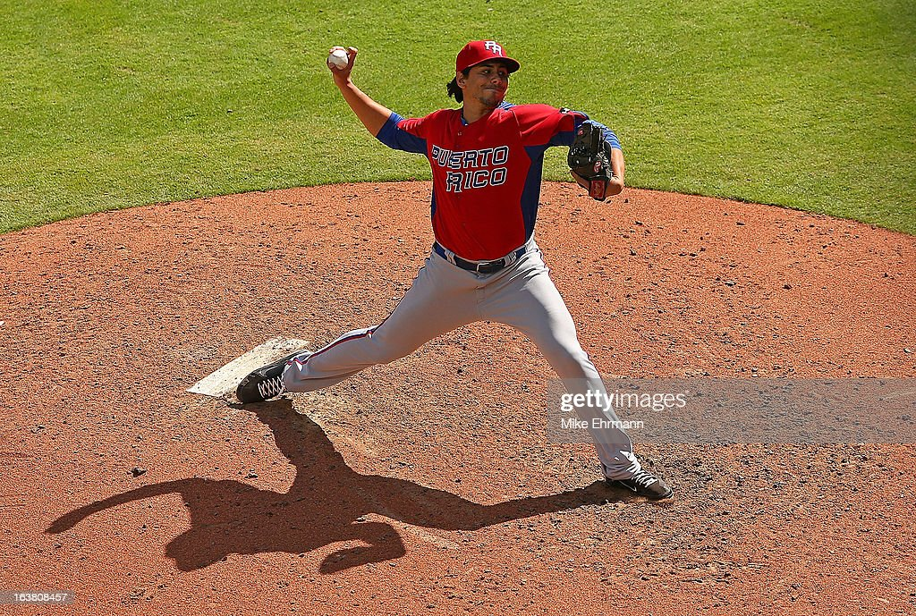 Randy Fontanez #33 of Puerto Rico pitches during a World Baseball Classic second round game against the Dominican Republicat Marlins Park on March 16, 2013 in Miami, Florida.