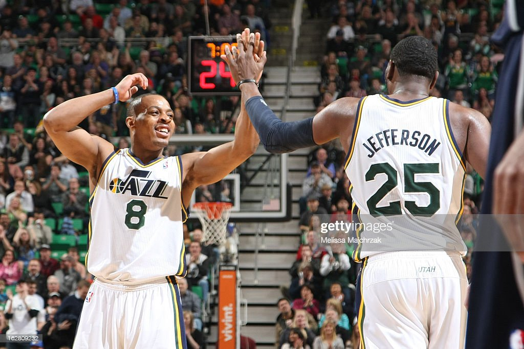 Randy Foye #8 and Al Jefferson #25 of the Utah Jazz high five during play against the Atlantic Hawks at Energy Solutions Arena on February 27, 2013 in Salt Lake City, Utah.