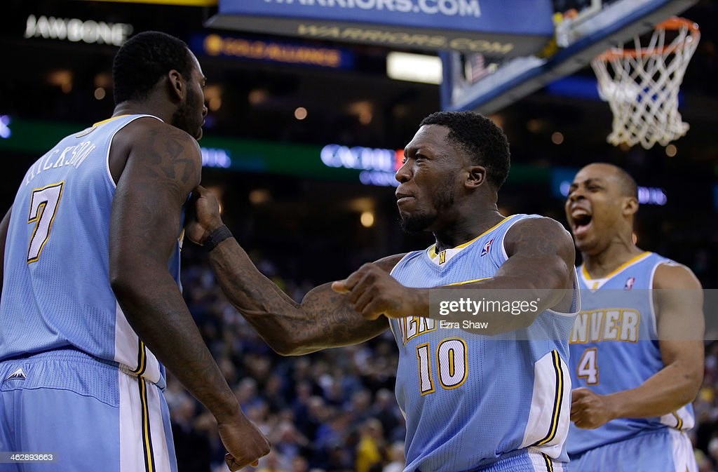Randy Foye #4 (R) and Nate Robinson #10 congratulate J.J. Hickson #7 of the Denver Nuggets after Hickson stole the ball from Stephen Curry #30 of the Golden State Warriors and then made a layup in the final minute of their game at ORACLE Arena on January 15, 2014 in Oakland, California.