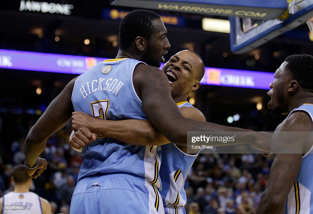 Randy Foye #4 (C) and Nate Robinson #10 congratulate J.J. Hickson #7 of the Denver Nuggets after Hickson stole the ball from Stephen Curry #30 of the Golden State Warriors and then made a layup in the final minute of their game at ORACLE Arena on January 15, 2014 in Oakland, California.