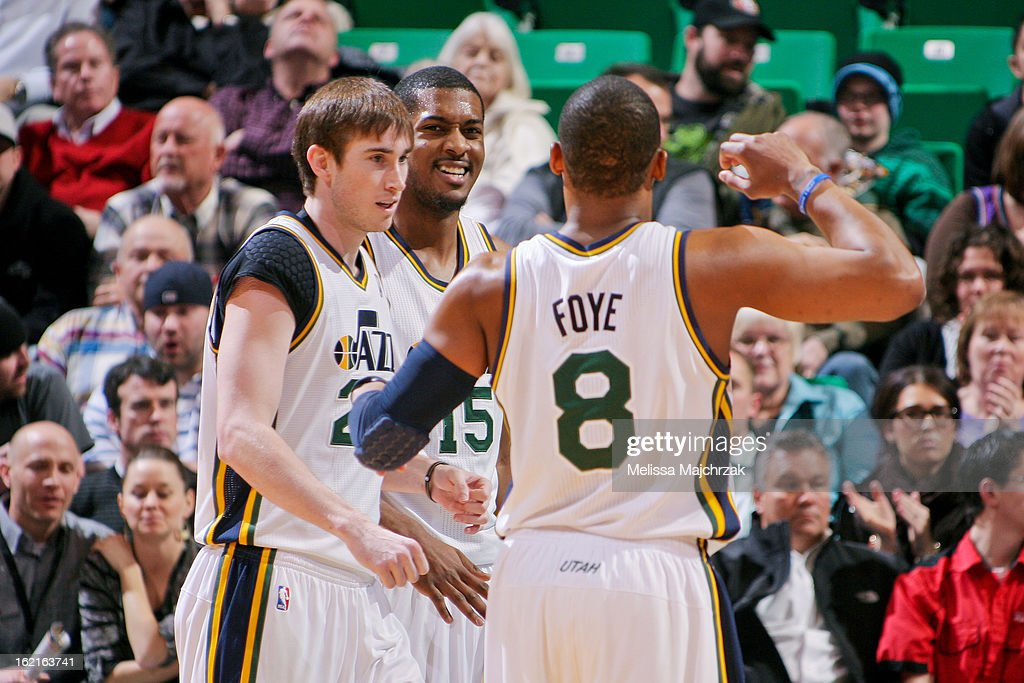 Randy Foye #8, Gordon Hayward #15, and Derrick Favors #15 of the Utah Jazz celebrate during their game against the Golden State Warriors at Energy Solutions Arena on February 19, 2013 in Salt Lake City, Utah.