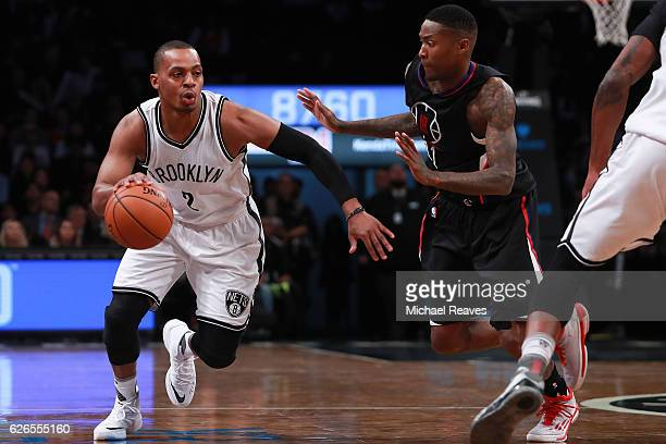 Randy Foye of the Brooklyn Nets drives to the basket defended by Jamal Crawford of the Los Angeles Clippers in the first half at Barclays Center on...