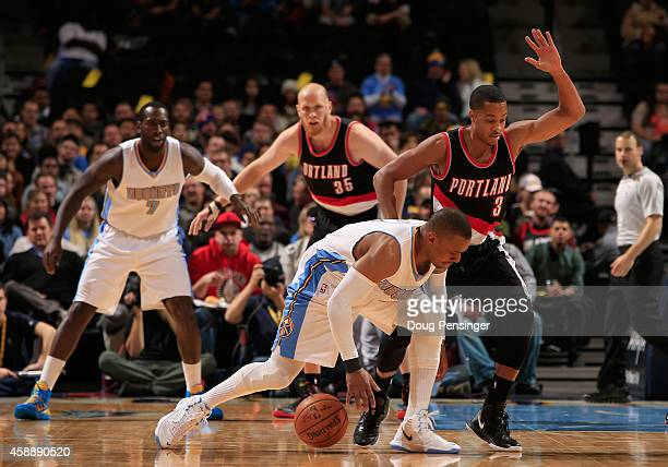 Randy Foye of the Denver Nuggets attempts to control the ball against CJ McCollum of the Portland Trail Blazers at Pepsi Center on November 12 2014...