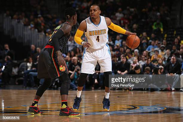 Randy Foye of the Denver Nuggets controls the ball against Dennis Schroder of the Atlanta Hawks at Pepsi Center on January 25 2016 in Denver Colorado...