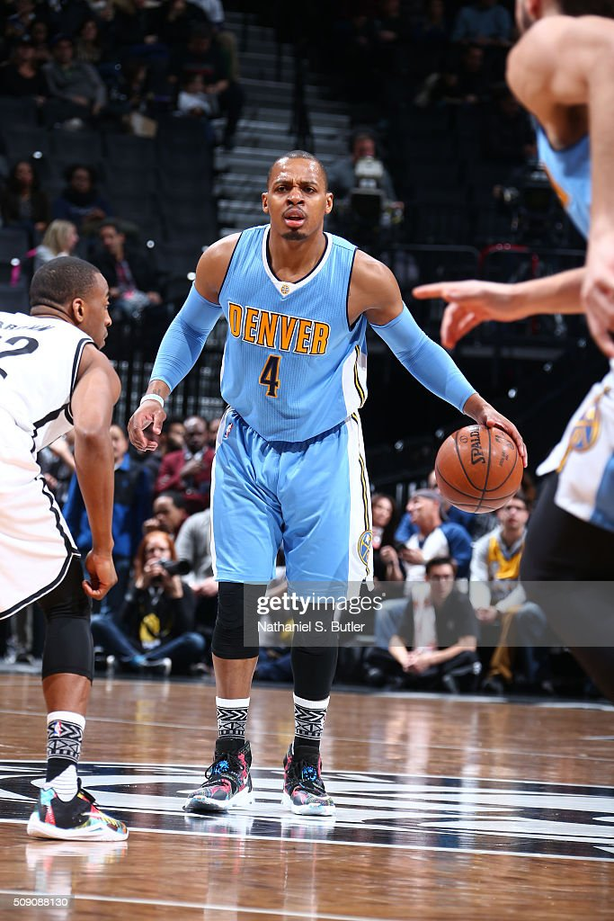<a gi-track='captionPersonalityLinkClicked' href=/galleries/search?phrase=Randy+Foye&family=editorial&specificpeople=240185 ng-click='$event.stopPropagation()'>Randy Foye</a> #4 of the Denver Nuggets defends the ball against the Brooklyn Nets during the game on February 8, 2016 at Barclays Center in Brooklyn, New York.