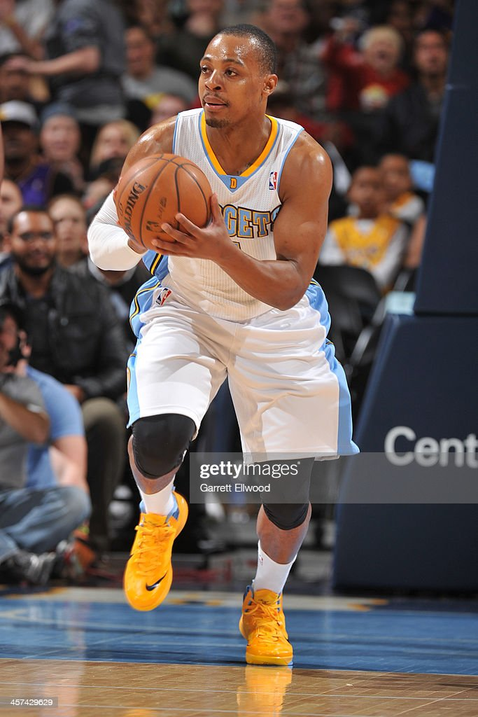 <a gi-track='captionPersonalityLinkClicked' href=/galleries/search?phrase=Randy+Foye&family=editorial&specificpeople=240185 ng-click='$event.stopPropagation()'>Randy Foye</a> #4 of the Denver Nuggets dribbles the ball against the Los Angeles Lakers on November 13, 2013 at the Pepsi Center in Denver, Colorado.