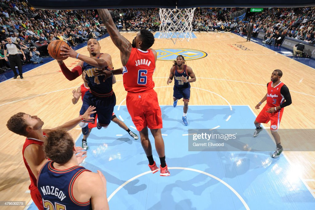 <a gi-track='captionPersonalityLinkClicked' href=/galleries/search?phrase=Randy+Foye&family=editorial&specificpeople=240185 ng-click='$event.stopPropagation()'>Randy Foye</a> #4 of the Denver Nuggets drives to the basket against the Los Angeles Clippers on March 17, 2014 at the Pepsi Center in Denver, Colorado.