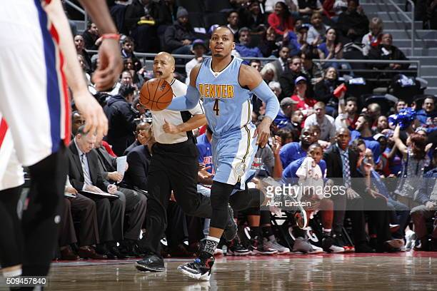 Randy Foye of the Denver Nuggets drives to the basket against the Detroit Pistons during the game on February 10 2016 at The Palace of Auburn Hills...