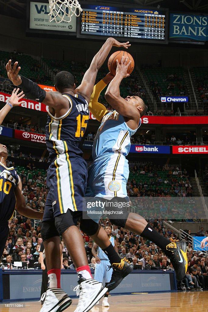 Randy Foye #4 of the Denver Nuggets goes to the basket against Derrick Favors #15 of the Utah Jazz at EnergySolutions Arena on November 11, 2013 in Salt Lake City, Utah.