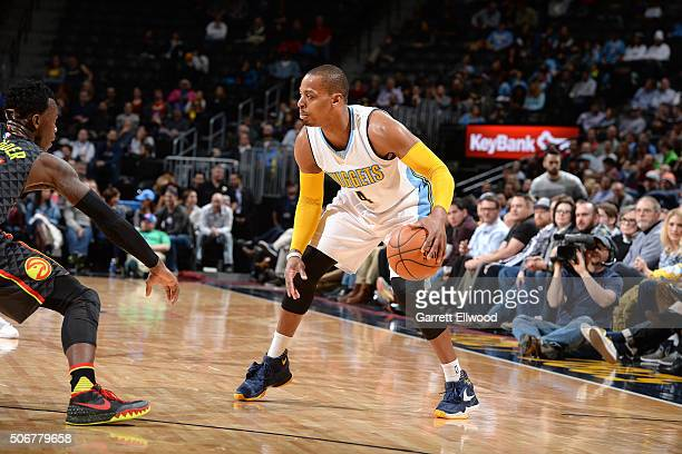 Randy Foye of the Denver Nuggets handles the ball during the game against the Atlanta Hawks on January 25 2016 at the Pepsi Center in Denver Colorado...