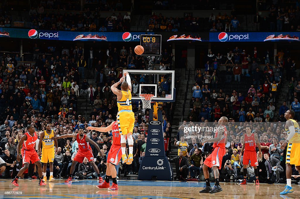 <a gi-track='captionPersonalityLinkClicked' href=/galleries/search?phrase=Randy+Foye&family=editorial&specificpeople=240185 ng-click='$event.stopPropagation()'>Randy Foye</a> #4 of the Denver Nuggets hits the game winning shot against the Los Angeles Clippers on February 3, 2014 at the Pepsi Center in Denver, Colorado.